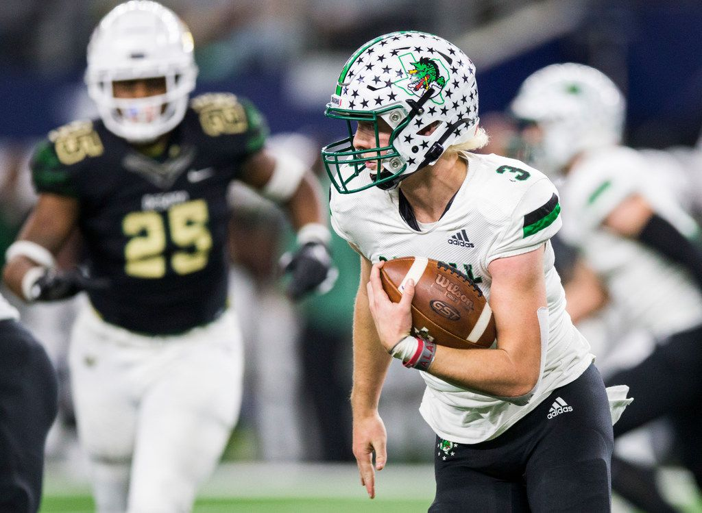 Southlake Carroll quarterback Quinn Ewers (3) runs the ball during the fourth quarter of a Class 6A Division I area-round high school football playoff game between Southlake Carroll and DeSoto on Friday, November 22, 2019 at AT&T Stadium in Arlington.