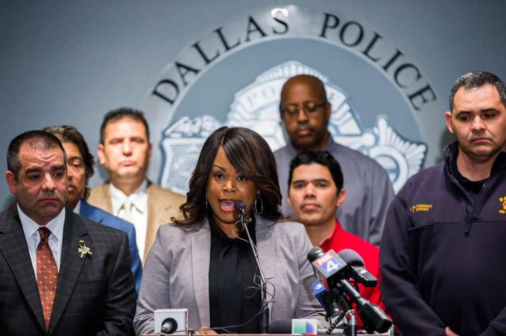 Dallas police and firefighters, shown here at a January news conference in Dallas, face deep cuts in pension benefits and higher contributions as part of a proposed fix for the troubled retirement system. (Ashley Landis/The Dallas Morning News)