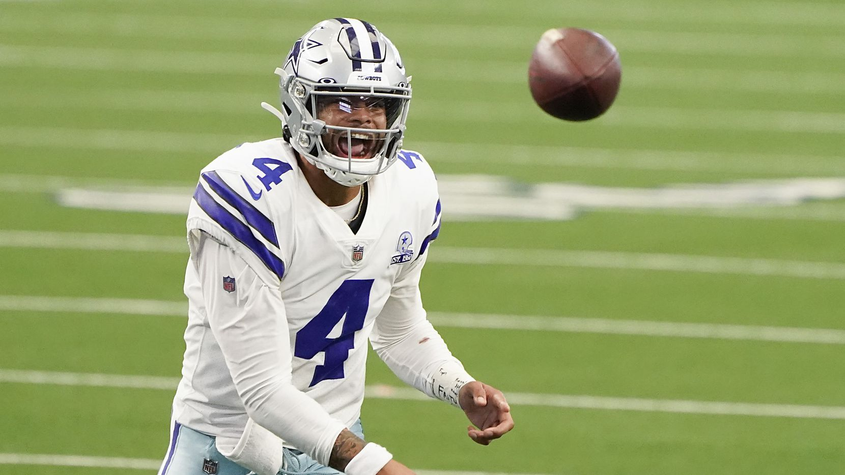 FILE - Cowboys quarterback Dak Prescott throws a pass during the second quarter of a game against the Falcons at AT&T Stadium on Sunday, Sept. 20, 2020, in Arlington.