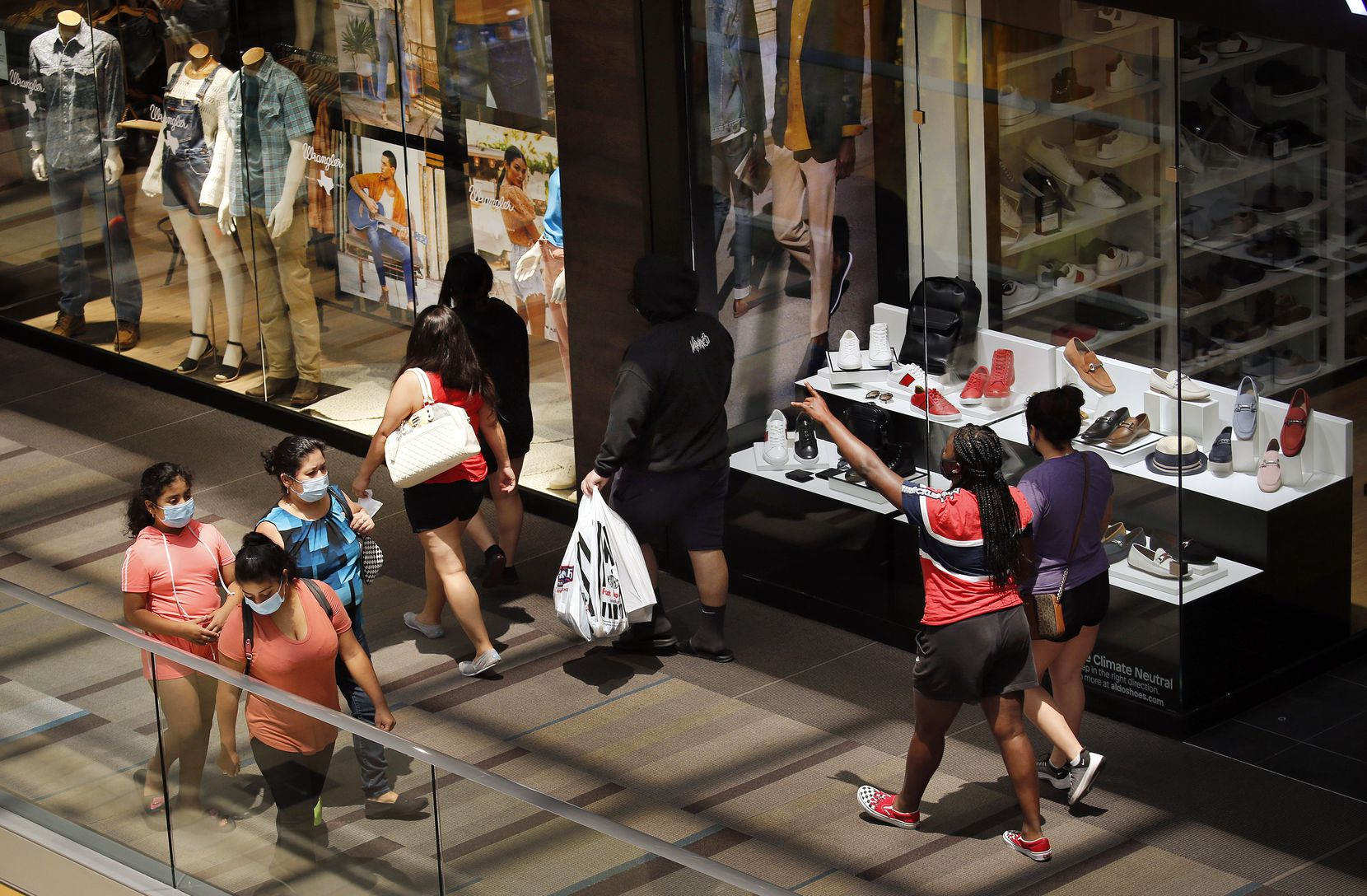 Shoppers return to the Galleria Dallas, Friday, June 5, 2020. The mall was closed this week in the wake of looting in several cities that stemmed from the protests over George Floyd's in-police custody death.