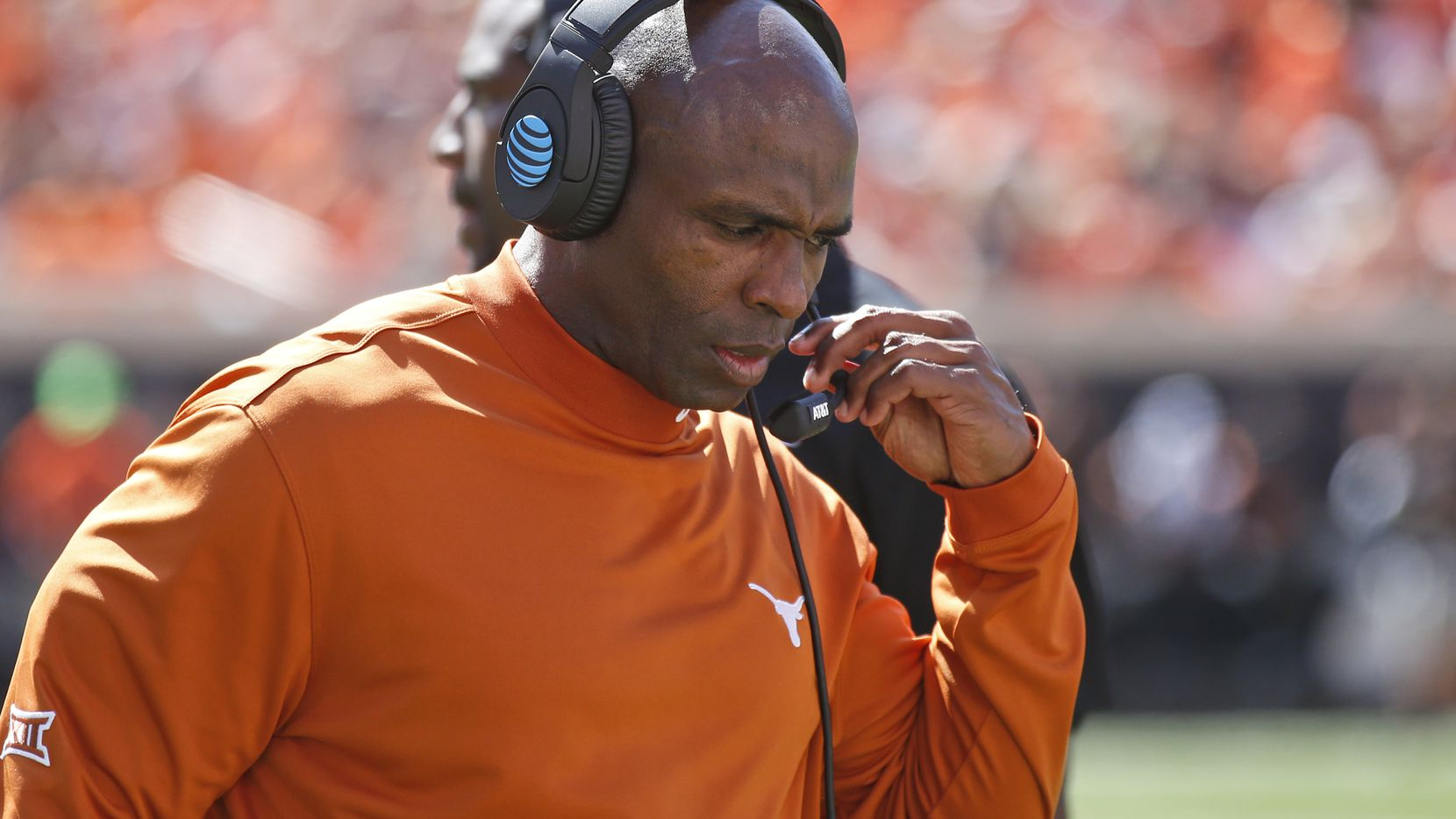 Texas head coach Charlie Strong walks along the sideline during an NCAA college football game against Oklahoma State in Stillwater, Okla., Saturday, Oct. 1, 2016. Oklahoma State won 49-31.