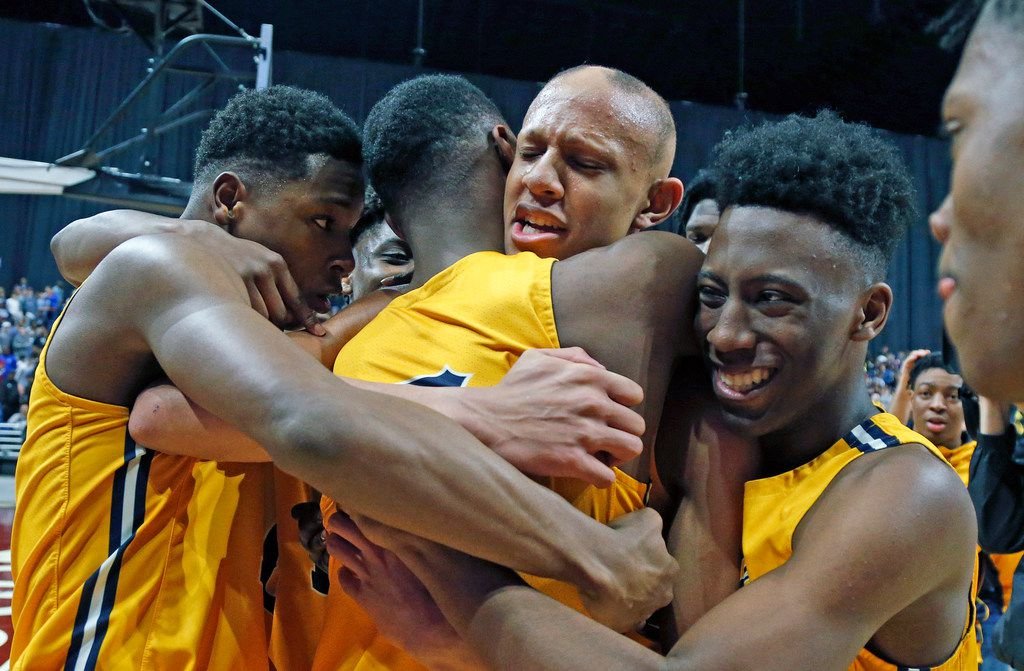 Oak Cliff Faith Academy's Jordan Walsh #23 is hugged by teammates after hitting game winning basket. UIL boys basketball 4A State Final between Oak Cliff Academy v Liberty Hill on Saturday March 9, 2019 at the Alamodome in San Antonio, Texas. (Ron Cortes/ Special Contributor) ORG XMIT: 10044099A