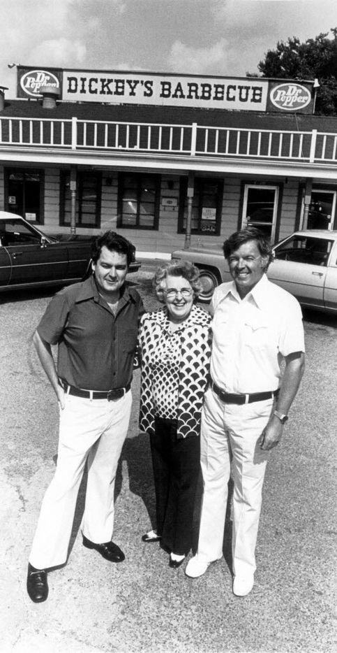 Roland Dickey Sr. (left),  Mama Ollie Dickey and T.D. Dickey Jr. in front of  Store #1 on North Central Expressway at Knox/Henderson in 1976.