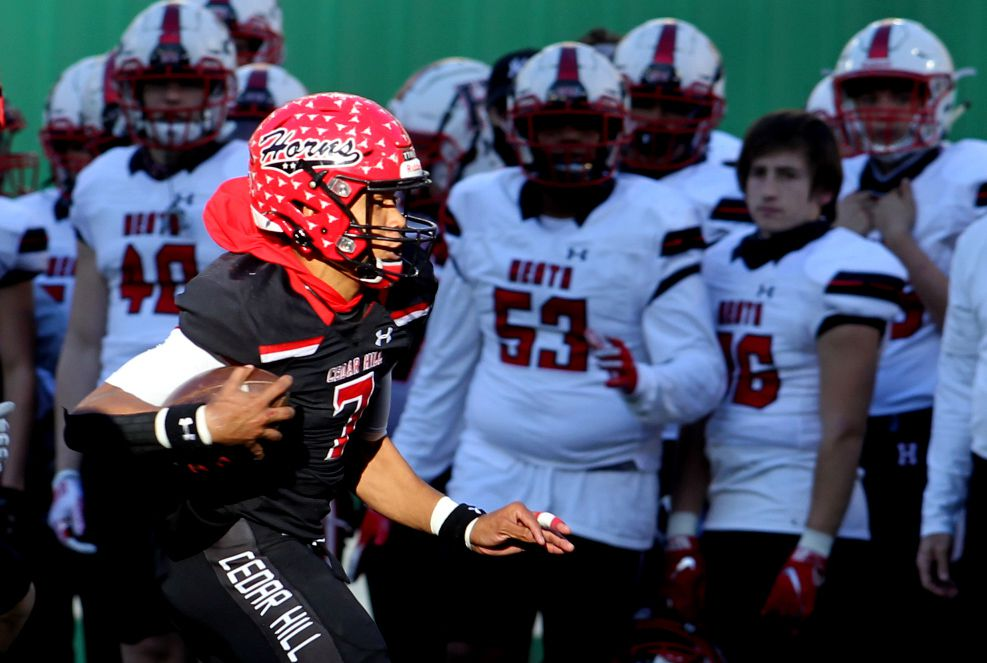 Cedar Hill quarterback Kaidon Salter (7) scampers down the sideline in front of the Rockwall Heath bench during a 2nd quarter rush. The two teams played their Class 6A Division ll Region ll final football playoff game at Globe Life Park in Arlington on January 2, 2021. (Steve Hamm/ Special Contributor)