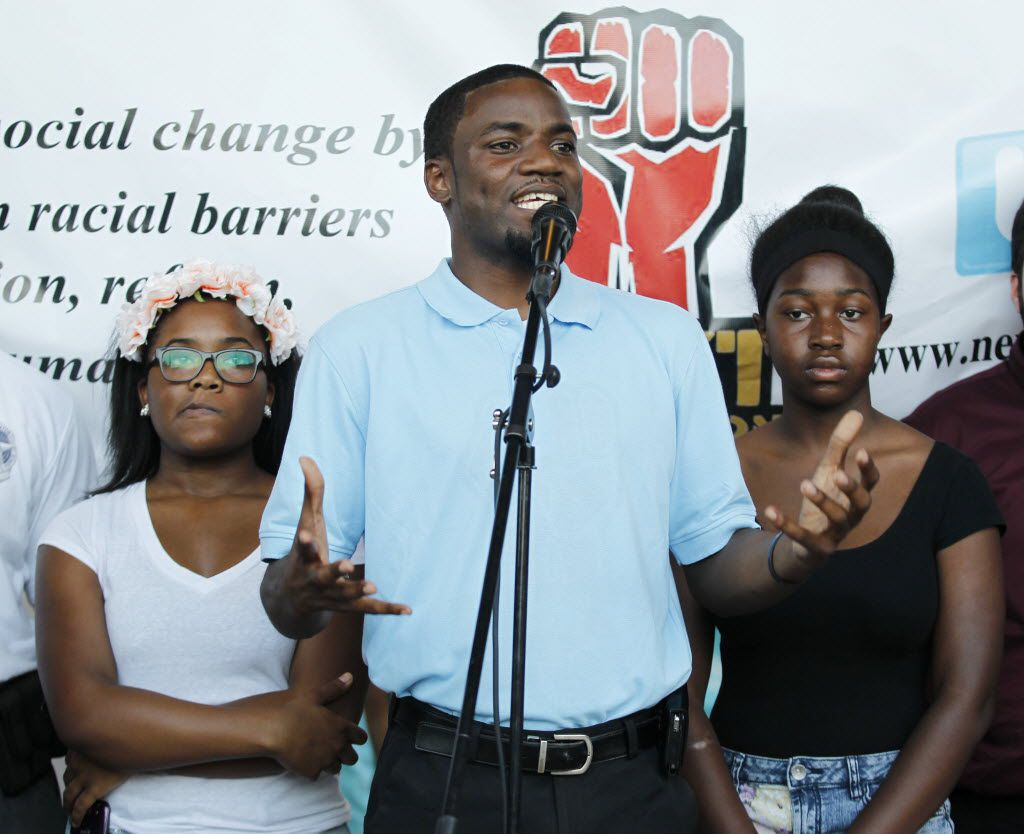 Dominique Alexander, president of the Next Generation Action Network, spoke at a protest in front of the McKinney Police Department last year. With him were two of teenage girls who where recorded in a seven-minute video where McKinney police officer Eric Casebolt appeared to aggressively attempt to eject them from a swimming pool.  (File Photo/Staff)