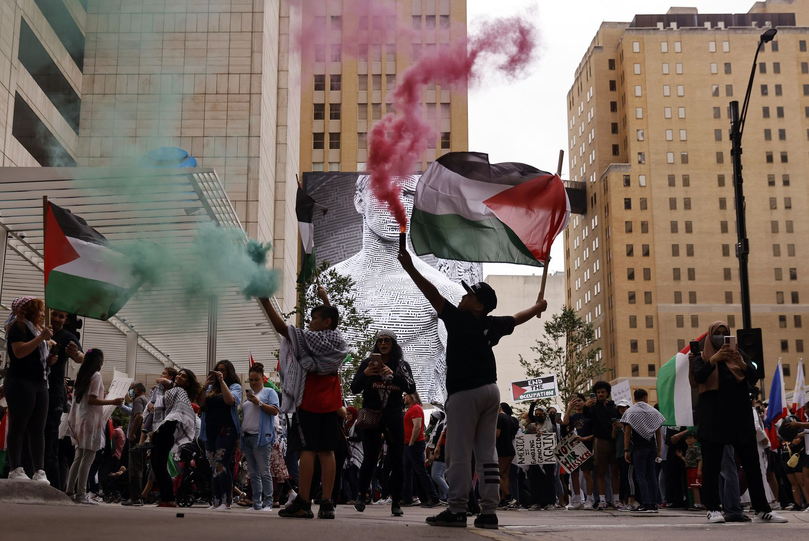 Some demonstrators set off red and green smoke in honor of Palestine.