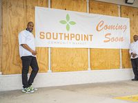 Cornerstone Baptist Church pastor Chris Simmons (right) is opening a small grocery market in the Cornerstone Heights neighborhood. Donald Wesson (left), program director at the church, can be seen on the left in this image taken April 7 in Dallas.