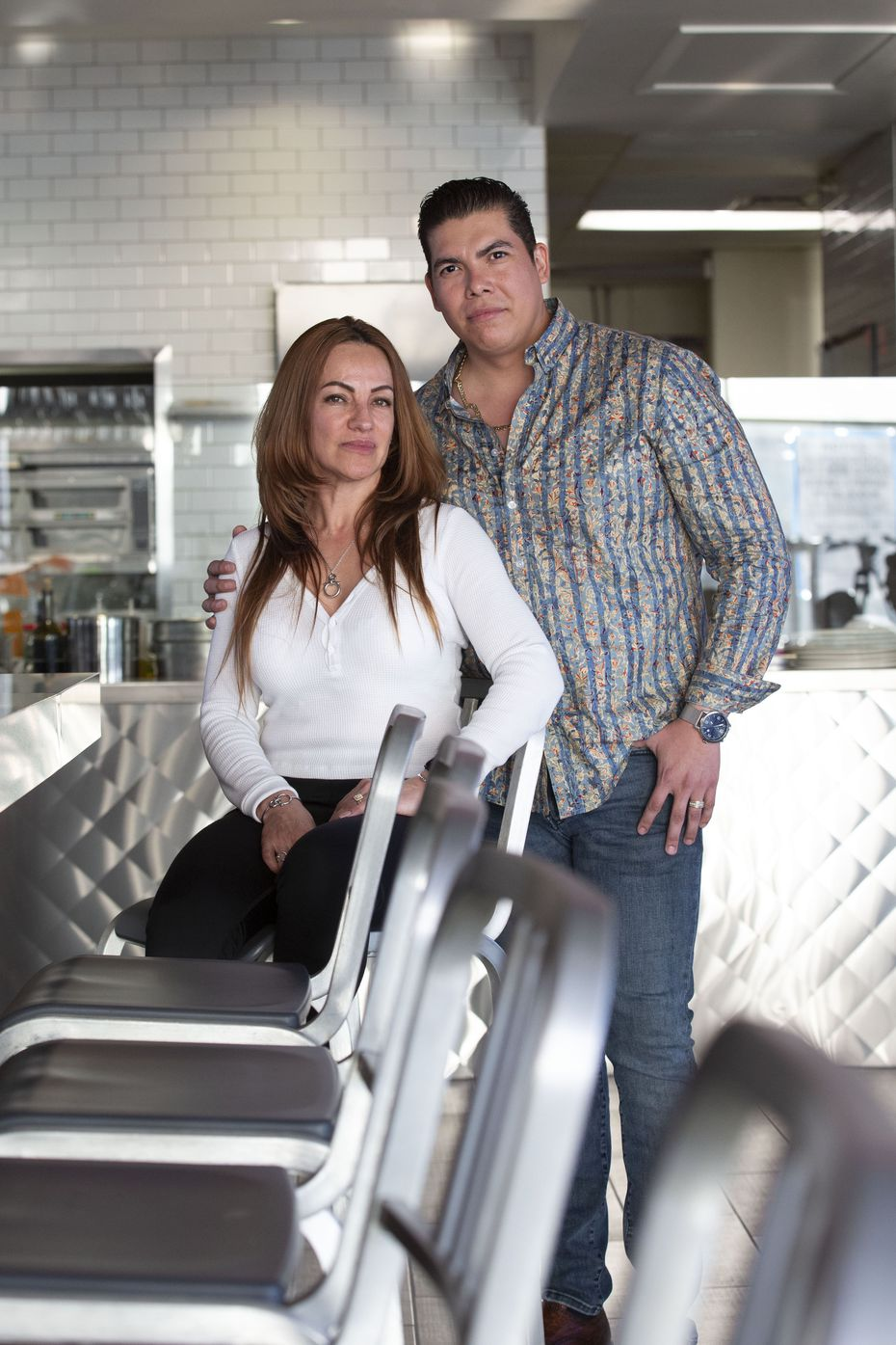 Mayra Orozco (left) and husband Sixto Alvarado are shown in their new restaurant Caribbean's Shark Seafood in Dallas.