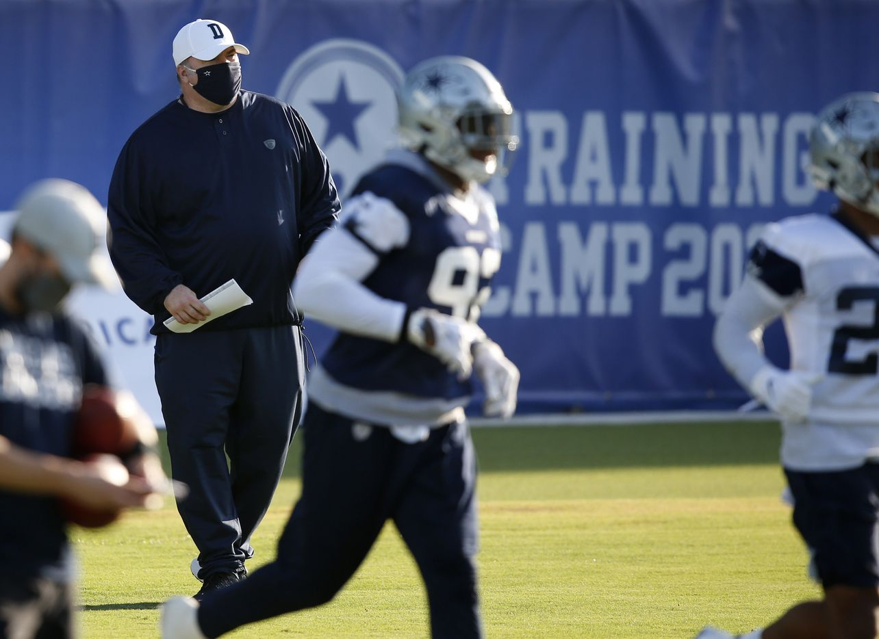 Dallas Cowboys head coach Mike McCarthy watches the team practice during the first day of training camp at Dallas Cowboys headquarters at The Star in Frisco, Texas on Friday, August 14, 2020. (Vernon Bryant/The Dallas Morning News)