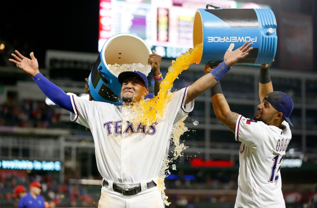 Texas Rangers left fielder Carlos Gomez (14) gets doused by second baseman Rougned Odor (12) after a 8-5 win over Milwaukee Brewers at Globe Life Park in Arlington, Texas, Wednesday, Sept. 28, 2016. (Jae S. Lee/The Dallas Morning News)
