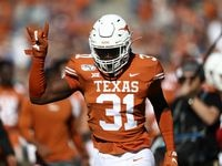 DALLAS, TEXAS - OCTOBER 12:  DeMarvion Overshown #31 of the Texas Longhorns runs off the field before the 2019 AT&T Red River Showdown at Cotton Bowl on October 12, 2019 in Dallas, Texas.