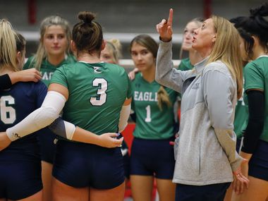 Eaton head coach Diane Wilson talks to her team during a time out in game one as Flower Mound Marcus High School hosted Eaton High School in a non-district volleyball match at Flower Mound Marcus High School on Tuesday, August 17, 2021. (Stewart F. House/Special Contributor)