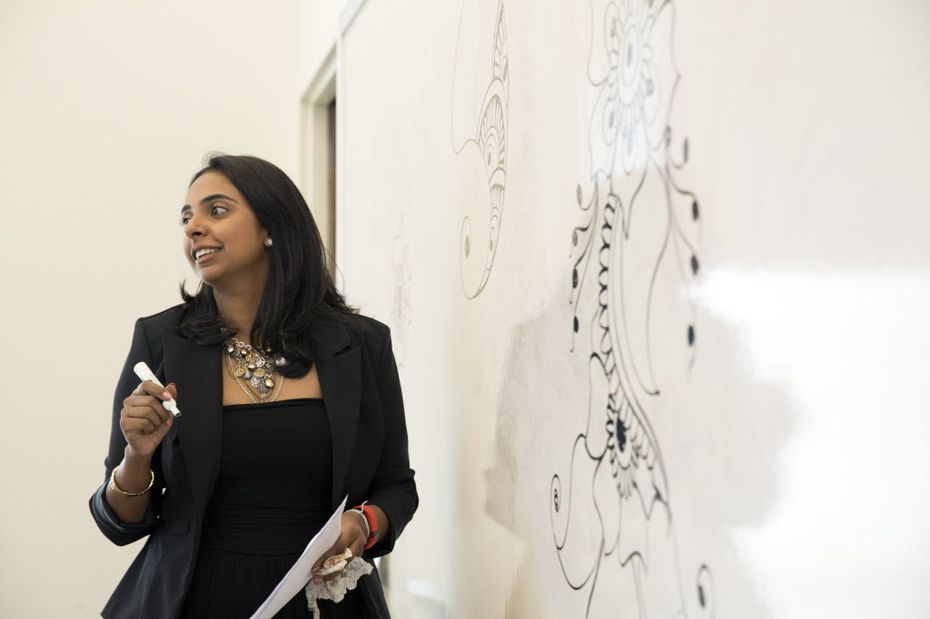Kiran Meghan teaches a basic henna class at Carrollton Public Library