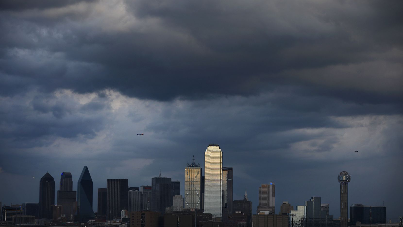 Thunderstorms clear downtown Dallas this evening ushering in north winds and cooler temperatures, Friday, April 6. Except temperatures in the 30's tomorrow morning.