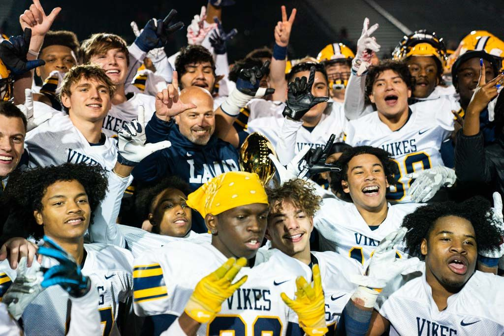 Arlington Lamar players and head coach Laban DeLay celebrate after winning a UIL Class 6A Division I bi-district playoff game between Euless Trinity and Arlington Lamar on Friday, November 15, 2019 at Pennington Field in Bedford. Arlington Lamar won 37-34.