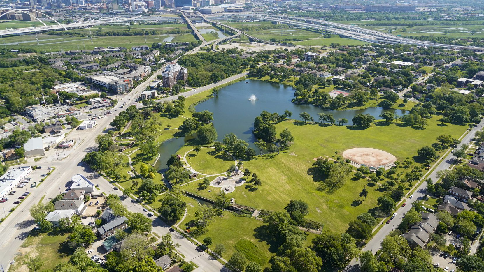 Aerial view of a Lake Cliff Park (bottom) with the downtown skyline on Thursday, April 16, 2020, in Dallas. (Smiley N. Pool/The Dallas Morning News)
