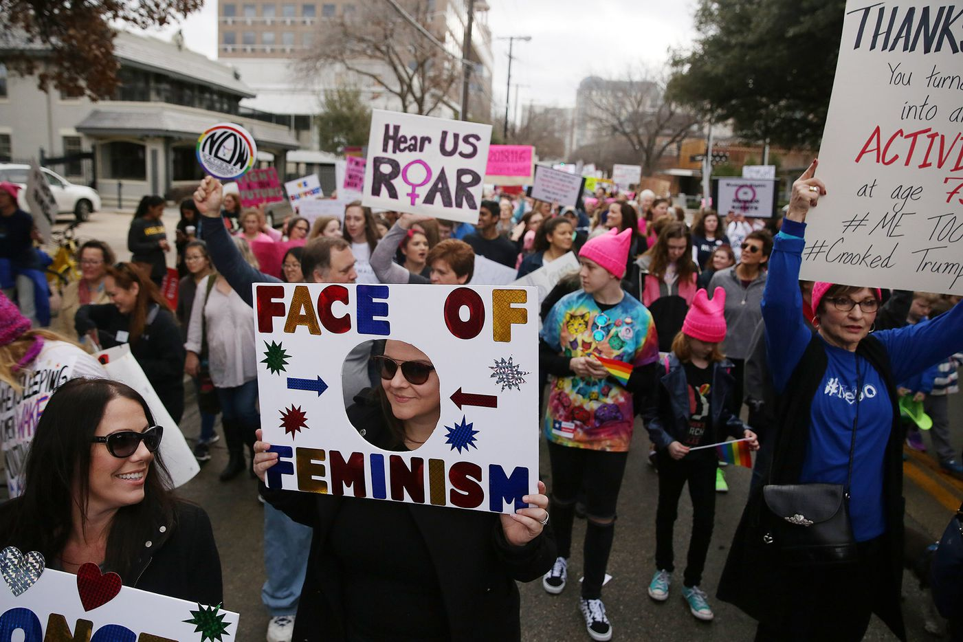 Marchers move Uptown during the Dallas Women's March in Dallas Saturday January 20, 2018. The march started at St. Paul United Methodist Church and ended at Pike Park in Uptown.