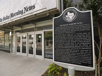 A historical marker near the entrance to The Dallas Morning News headquarters on Commerce Street in downtown Dallas.