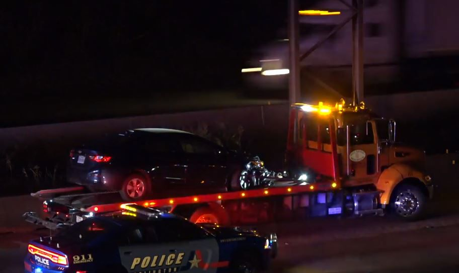 A damaged car sits on a tow truck after it was involved in a crash Wednesday night in Arlington.
