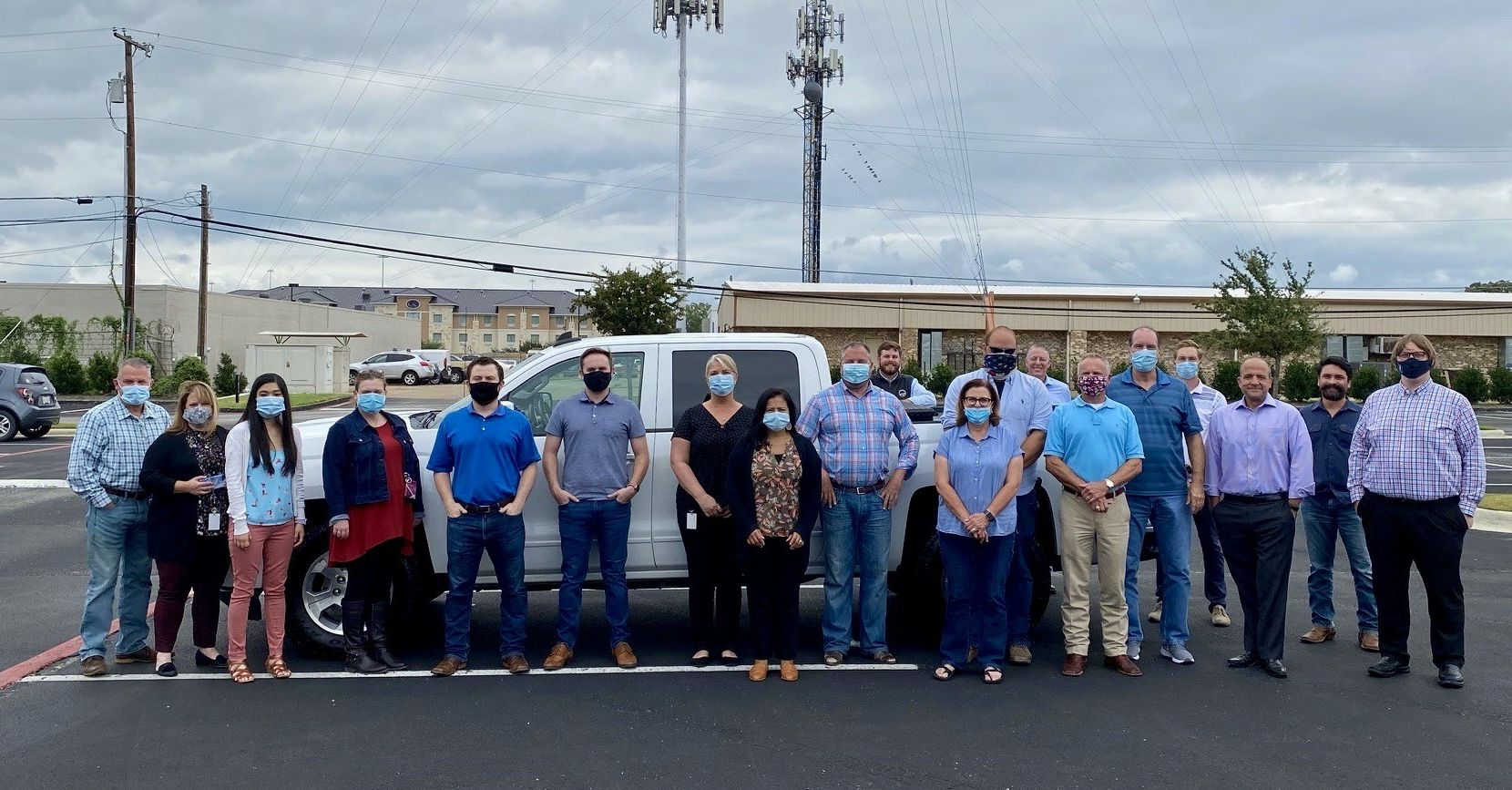 U.S. Energy Development Corporation and Mission Arlington staff pose together after the corporation donated a Chevy Silverado truck to the food pantry.