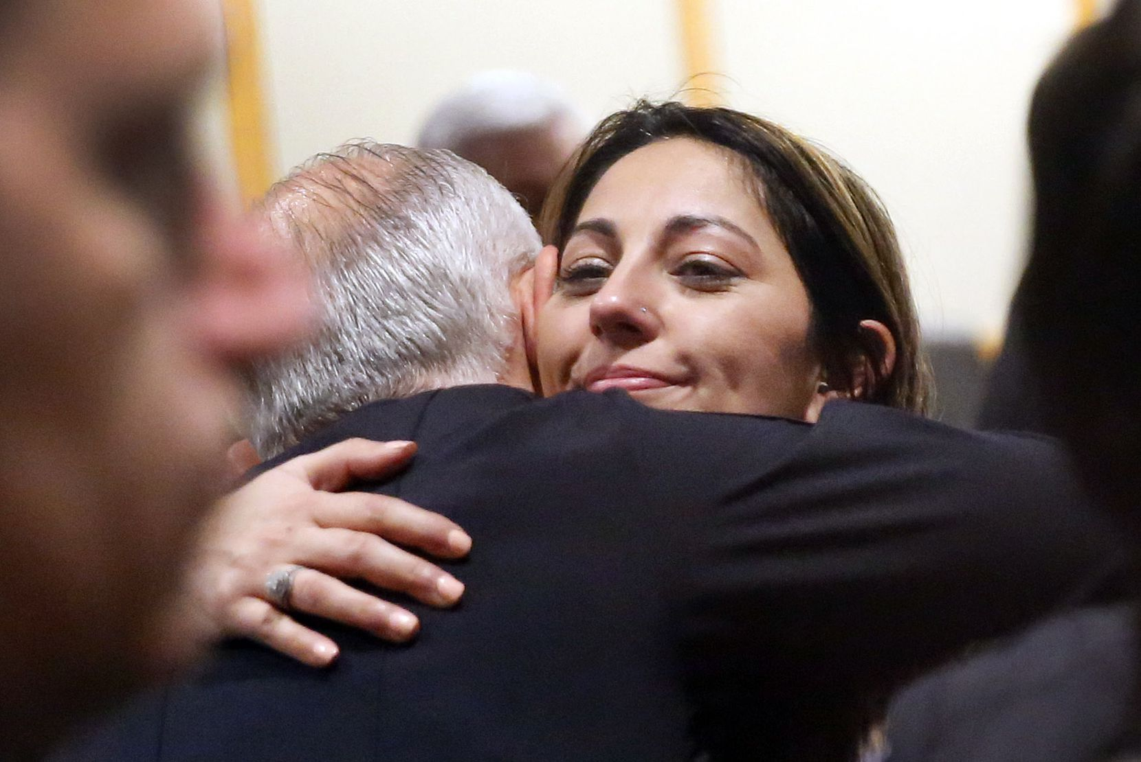 Nicole Sherrard, widow of slain Officer David Sherrard,  receives a hug from Richardson Police Chief Jimmy Spivey after Brandon McCall was sentenced to death.