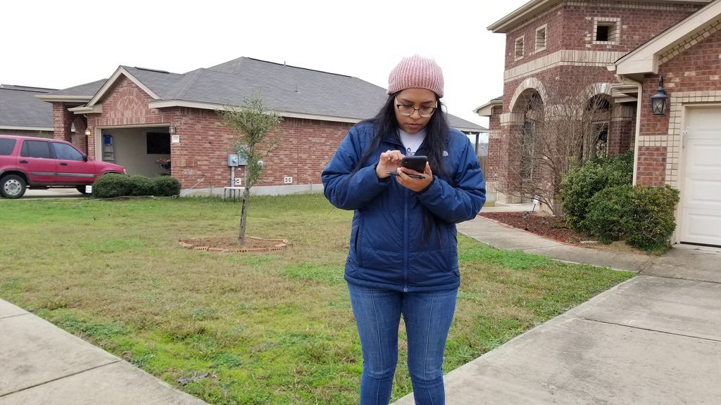 Congressional candidate Jessica Cisneros checks for the next home on her list as she campaigns in Live Oak, Texas, on Feb. 19, 2020.