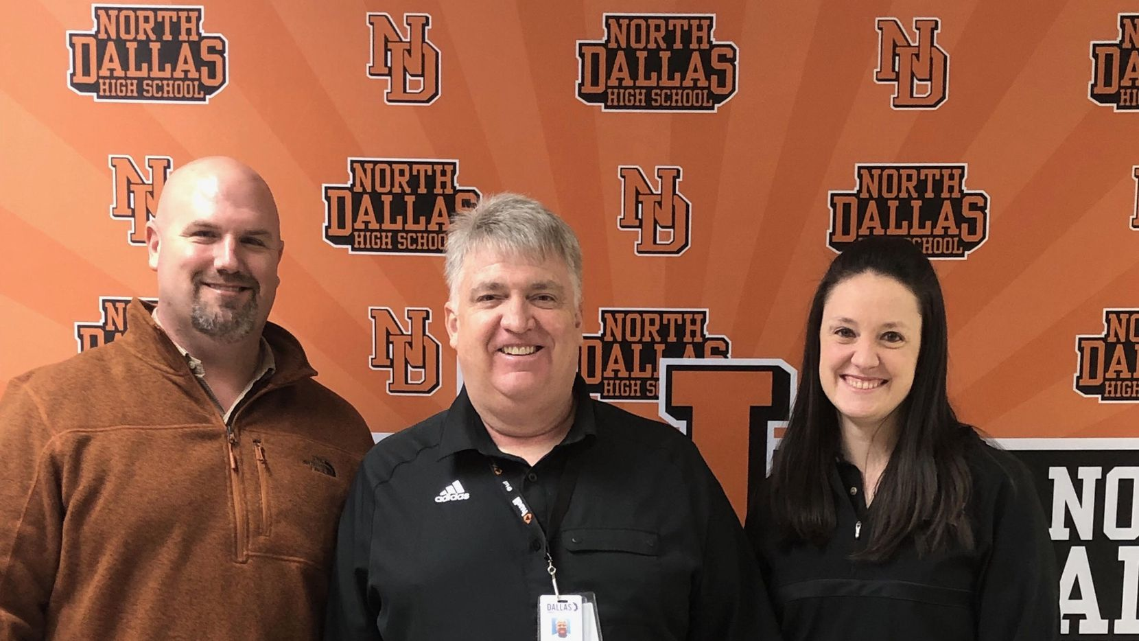 New North Dallas head coach Bobby Estes (middle), who coached the previous 21 years at Woodrow Wilson, stands with North Dallas athletic director Brian Barnett (left) and North Dallas school principal Katherine Eska on Feb. 8, 2019.