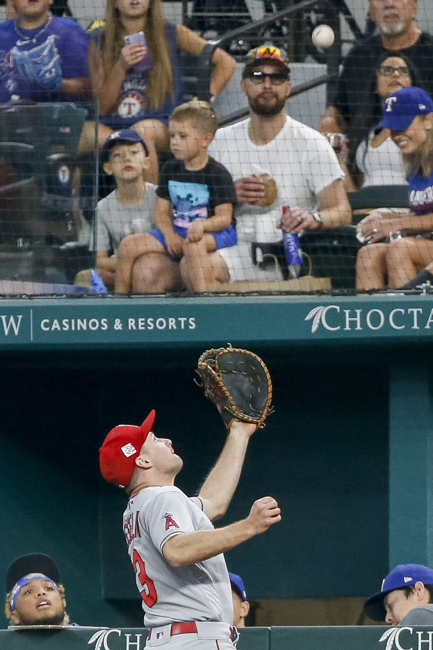 Los Angeles Angels first baseman Phil Gosselin (13) makes a play along the Texas Rangers dugout for an out during the fourth inning at Globe Life Field on Thursday, Aug. 5, 2021, in Arlington. (Elias Valverde II/The Dallas Morning News)
