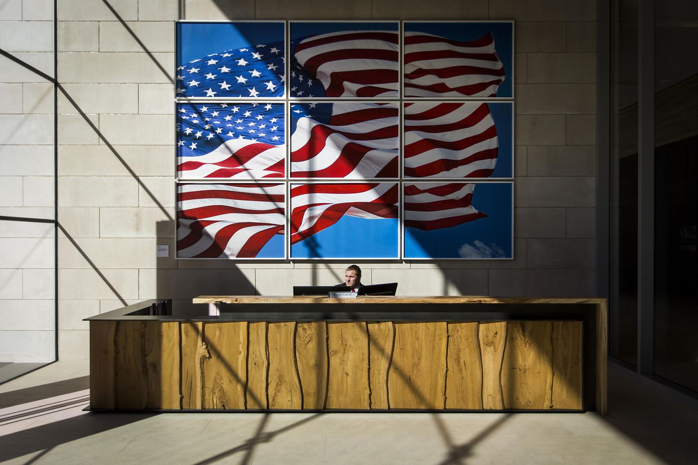 Security guard Mitchel Carroll works at the front desk of the new headquarters for the Perot companies.