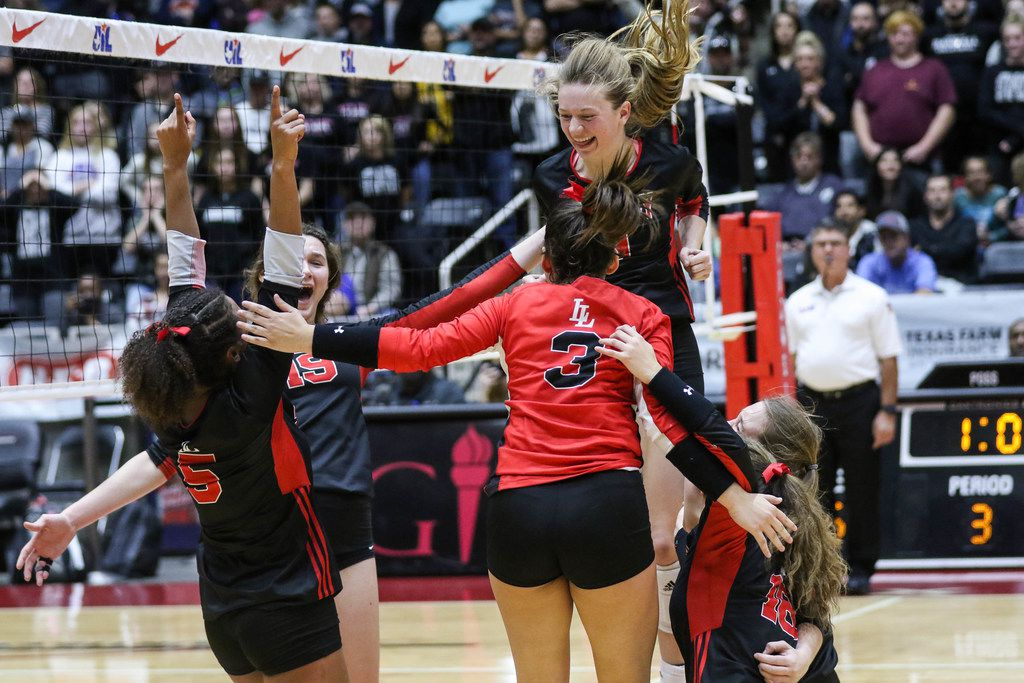 The Lucas Lovejoy Leopards celebrate after winning the scoring point in the final set of a class 5A volleyball state semifinal match against Canyon Randall at the Curtis Culwell Center in Garland, on Saturday, November 23, 2019. Lovejoy won all three sets 27-25, 25-17 and 25-15. (Juan Figueroa/The Dallas Morning News)