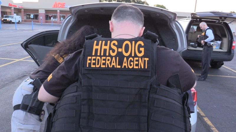 Federal agents suit up to make arrests for health care fraud as part of a nationwide sweep