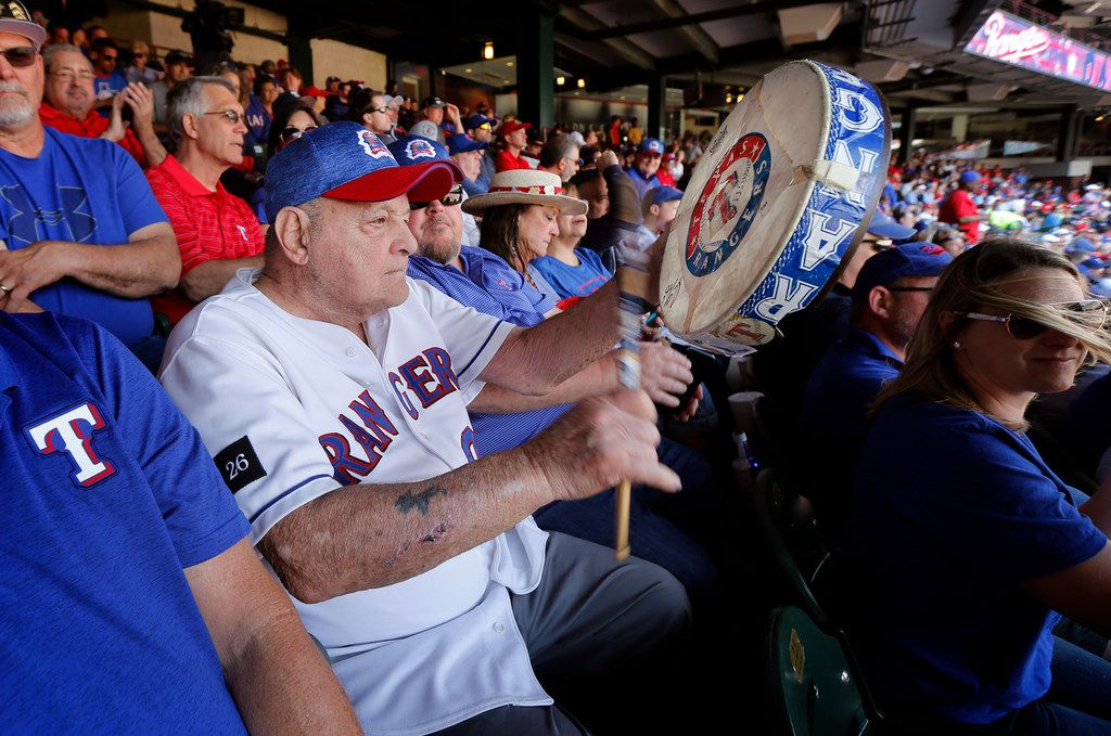 Zonk aka John Lanzillo Jr., 85, beats his worn drum with his signature cadence after Texas Rangers batter Rougned Odor got on base against the Chicago Cubs during Opening Day at Globe Life Park in Arlington, Thursday, March 28, 2019.