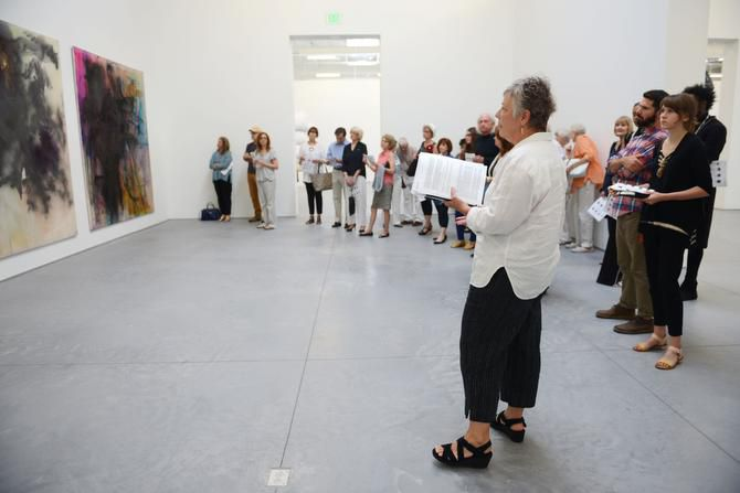 Artist Marilyn Jolly (foreground) leads a discussion on pieces of art by Sigmar Polke during a public tour at The Warehouse near the Galleria. The former industrial building, co-owned by Dallas art collectors Howard Rachofsky and Vernon Faulconer, houses works of art, some co-owned with Dallas Museum of Art, to be seen by appointment only.