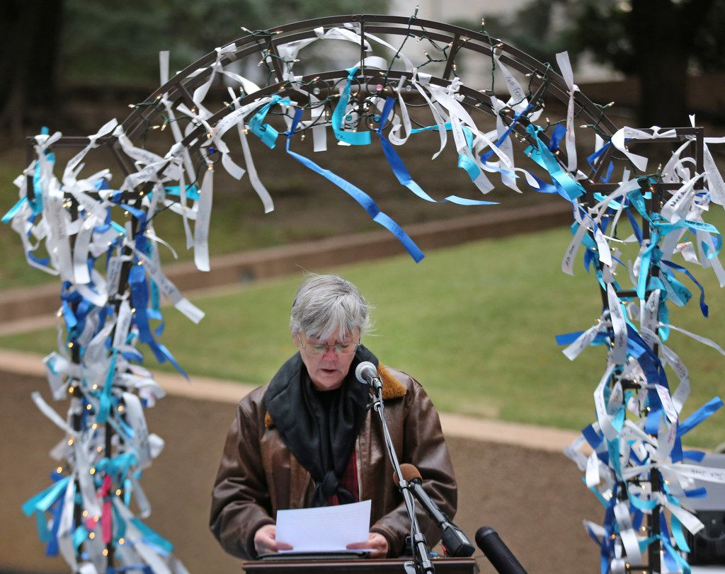 Leslie Sinclair-Worley shares memories of her father by telling about his experience as a Pearl Harbor survivor during a Pearl Harbor remembrance held at Thanks-Giving Square in downtown Dallas,  on Thursday, December 7, 2017. (Louis DeLuca/The Dallas Morning News)
