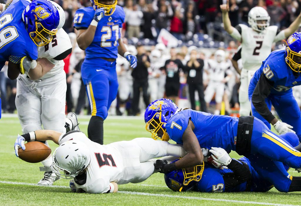 Argyle's Gage McCook (5) dives into the end zone for a touchdown as La Vega defensive back Brandon Benson (7) defends during the second half of the Class 4A Division I state championship football game at NRG Stadium on Friday, Dec. 18, 2015, in Houston. (Smiley N. Pool/The Dallas Morning News)