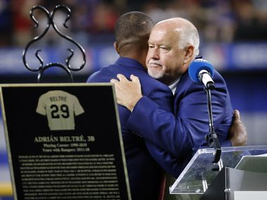 Former Texas Rangers third baseman Adrian Beltre (left) and Rangers vice president and public address announcer Chuck Morgan congratulate one another on being inducted into the Texas Rangers Baseball Hall of Fame at Globe Life Field in Arlington, Saturday, August 14, 2021.(Tom Fox/The Dallas Morning News)