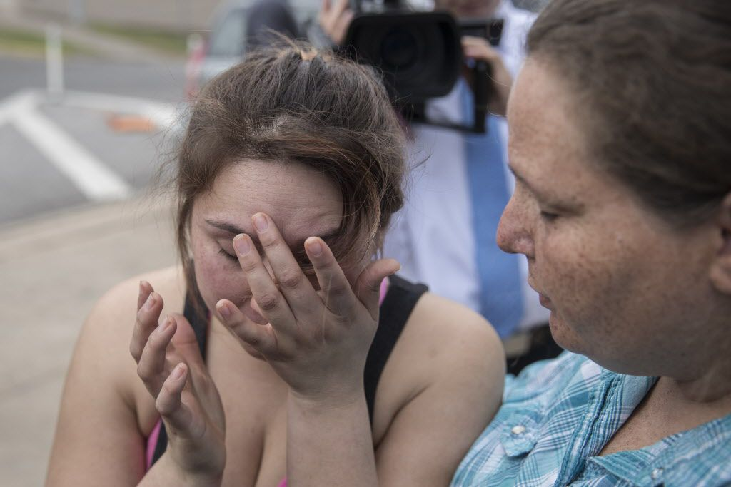 Angel Velazquez  is overcome with emotion as she speaks to local news media about how the U.S. Immigration and Customs Enforcement arrested her fiancé Hugo Baltazar Ramirez on Feb. 10, 2017. Her mother, Teresa Velazquez, consoles her.