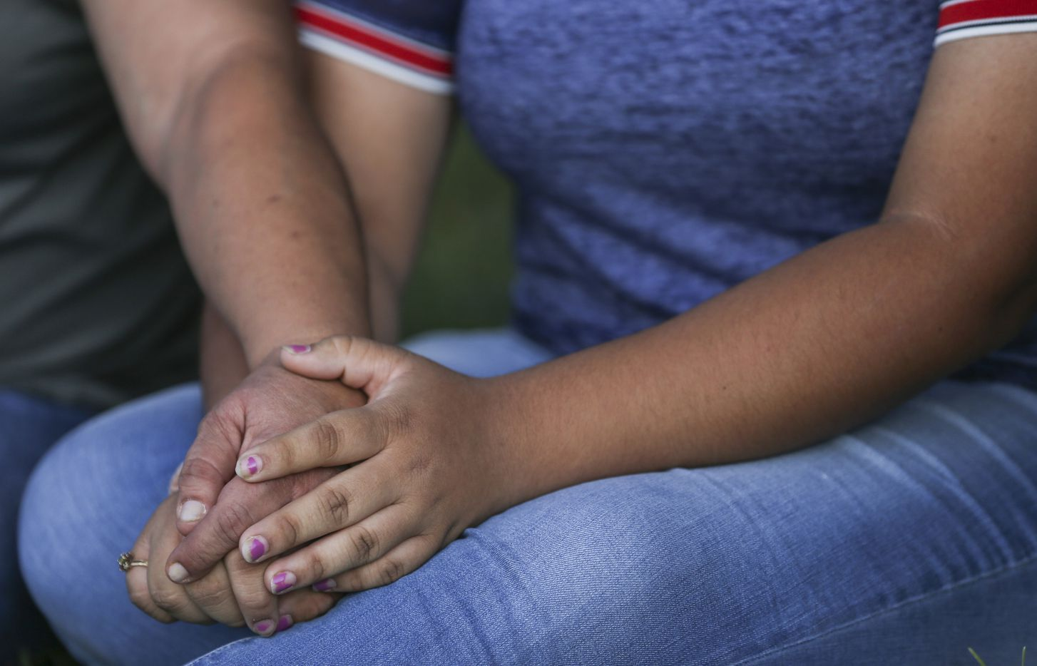 Christina Lopez, left, reaches over to comfort her daughter, Celia Lopez, 15, who was friends with Leilah Hernandez, a 15-year-old Odessa High sophomore killed in the attack, as community members gather for a prayer vigil at the University of Texas Permian Basin on Sunday, Sept. 1, 2019.