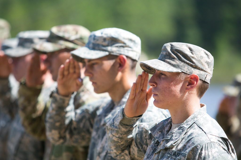 FORT BENNING, GA - AUGUST 21:  First Lt. Shaye Haver (R), of Copperas Cove, TX, salutes during the graduation ceremony of the United States Army's Ranger School on August 21, 2015 at Fort Benning, Georgia . Griest and Haver are the first women ever to successfully complete the U.S. Army's Ranger School.  (Photo by Jessica McGowan/Getty Images) ORG XMIT: 572040993