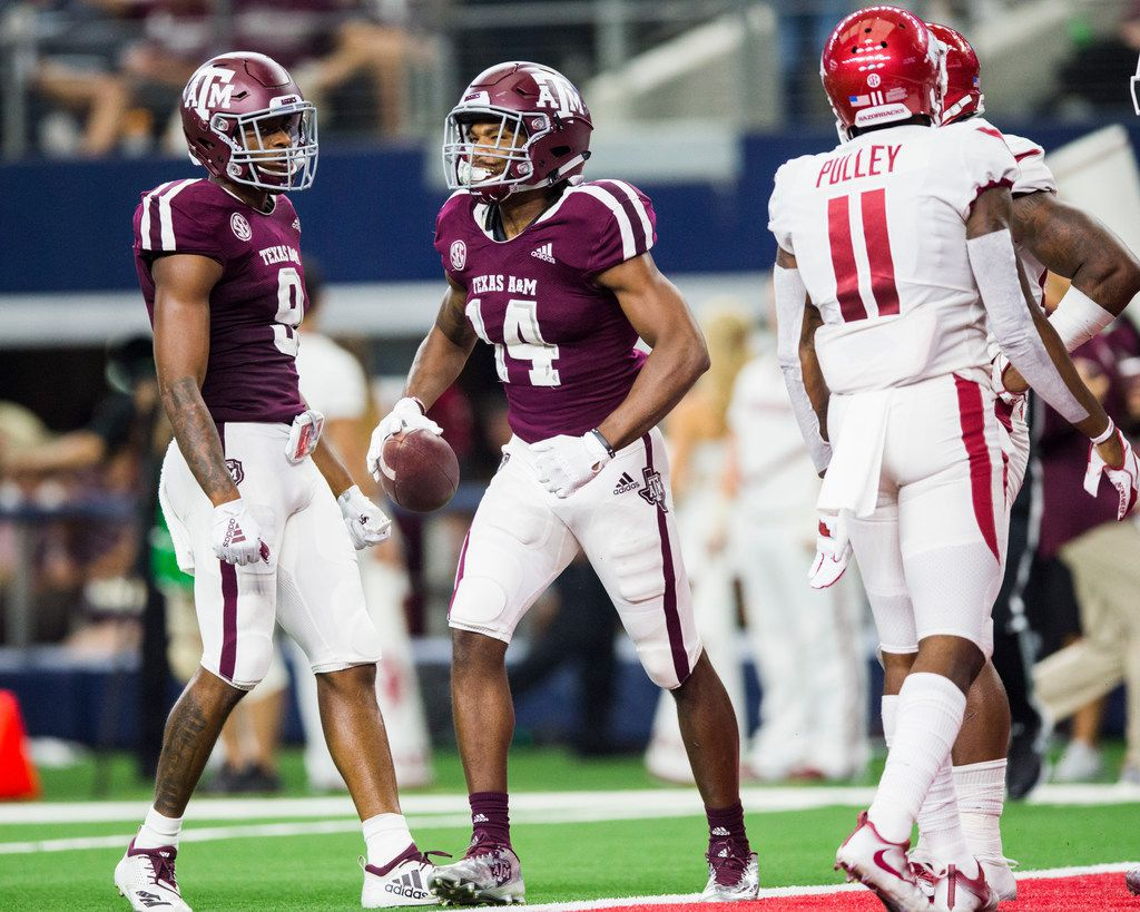 Texas A&M Aggies wide receiver Camron Buckley (14) celebrates a long run during the fourth quarter of an NCAA football game between Texas A&M and Arkansas on Saturday, September 29, 2018 at AT&T Stadium in Arlington, Texas. (Ashley Landis/The Dallas Morning News)