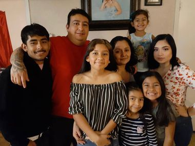 "Roberto ""Jesus"" Reta (second from left) poses for a photo with his family. Reta, who has worked as a cook at Tom's Burgers and Grill for more than 14 years, is in the hospital battling a sepsis infection. His family has turned to online fundraising to help pay his medical bills."