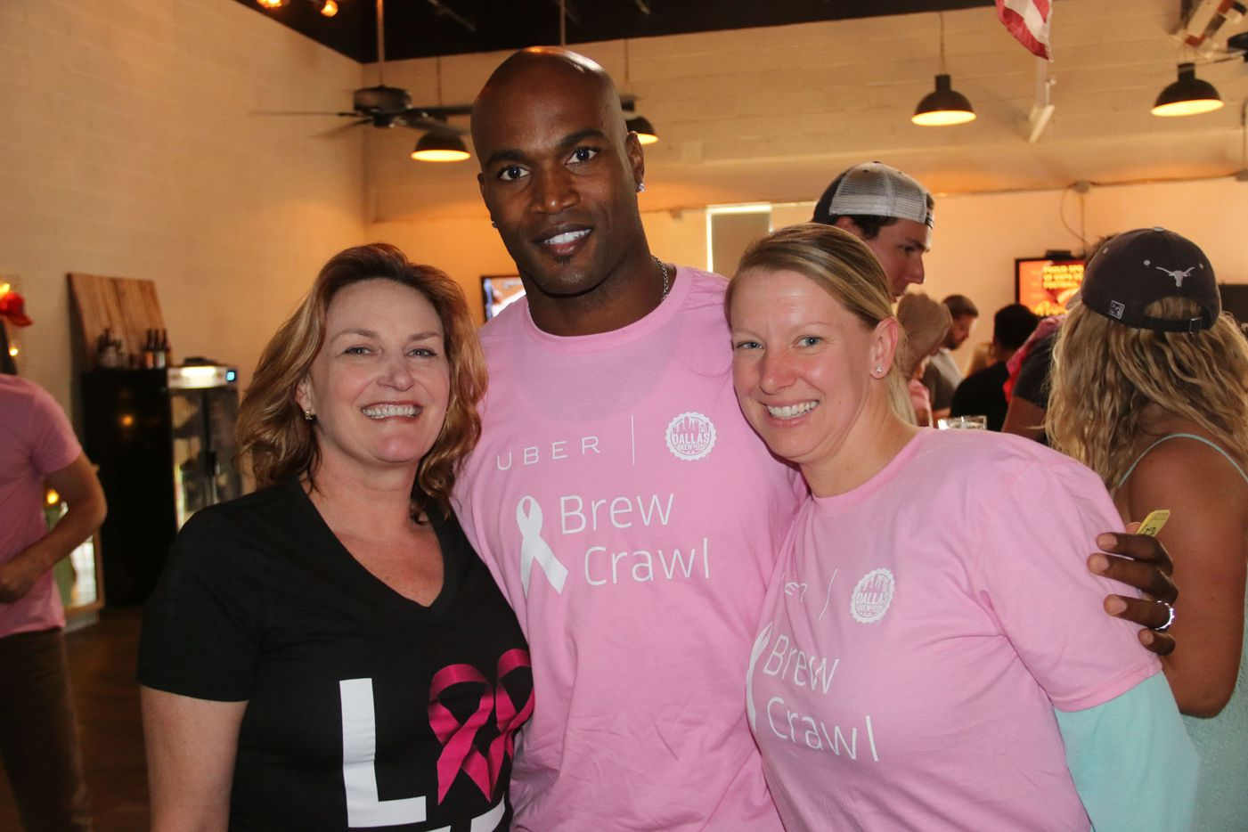 Susan McClure, former Dallas Cowboys player Bradie James and Kim Vowell  at Noble Rey Brewing Co. during the inaugural Brew Crawl for Breast Cancer on Saturday in Dallas. The event benefited James' Foundation 56 breast cancer nonprofit.