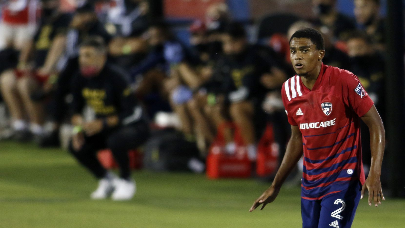 FC Dallas defender Reggie Cannon (2) stays alert in front of the team bench during first half action of their soccer match against Nashville FC. The MLS teams played their soccer match at Toyota Stadium in Frisco on August 16, 2020.