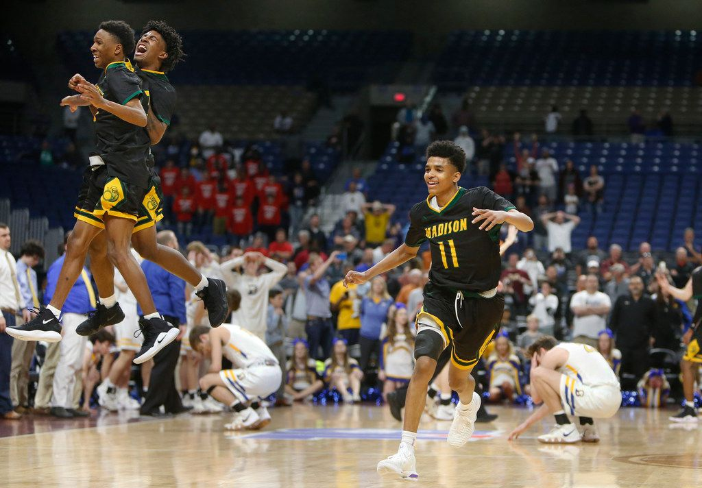 Madison's Jerome Henry #11  runs down cour as he is joined by  Madison's Dyeshun King #5 ,on Right in air, and  Madison's Jody Legans #13 in celebration of their 3A Championship. UIL boys basketball 3A State Final between Brock and Dallas Madison on Saturday March 9, 2019 at the Alamodome in San Antonio, Texas. (Ron Cortes/ Special Contributor) ORG XMIT: 10044100A