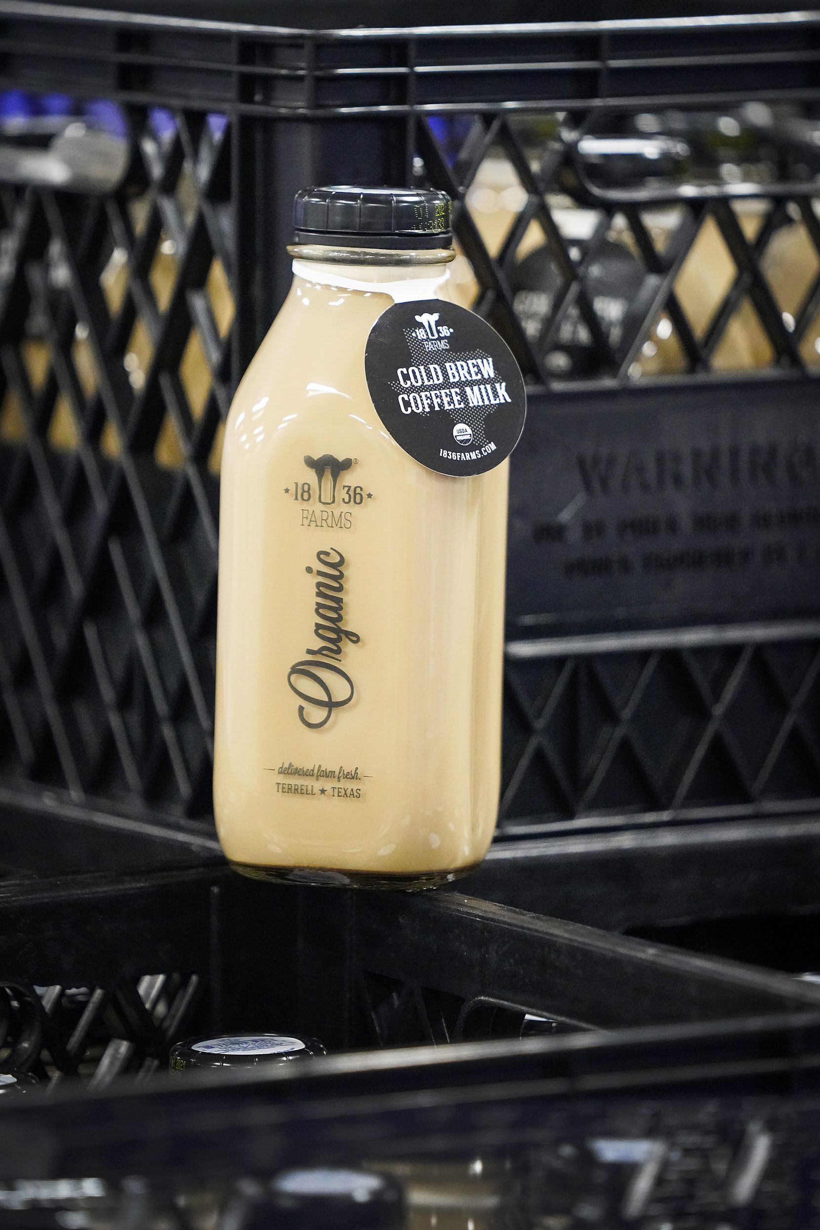 A bottle of cold brew coffee milk photographed in the cooler at 1836 Farms in Terrell on June 15, 2021.