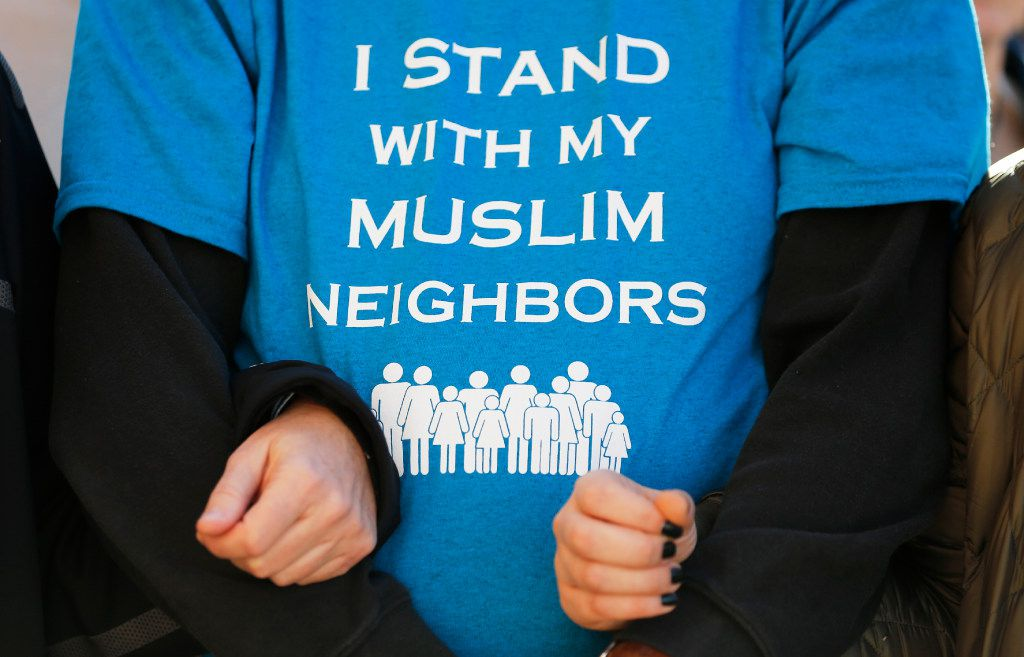 People stand arm in arm at a press conference at the steps of the Texas Capitol during the Texas Muslim Capitol Day rally in Austin on Tuesday, January 31, 2017.