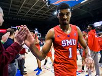 Southern Methodist Mustangs forward Feron Hunt (1) gets high-fives after an NCAA basketball game between SMU and UConn on Wednesday, February 12, 2020 at Moody Coliseum on the SMU campus in Dallas.