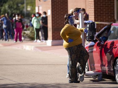 Curbside voting and voters are pictured during the first day of early voting at Disciple Central Community Church in DeSoto in October. The city will hold a special election on Feb. 2.