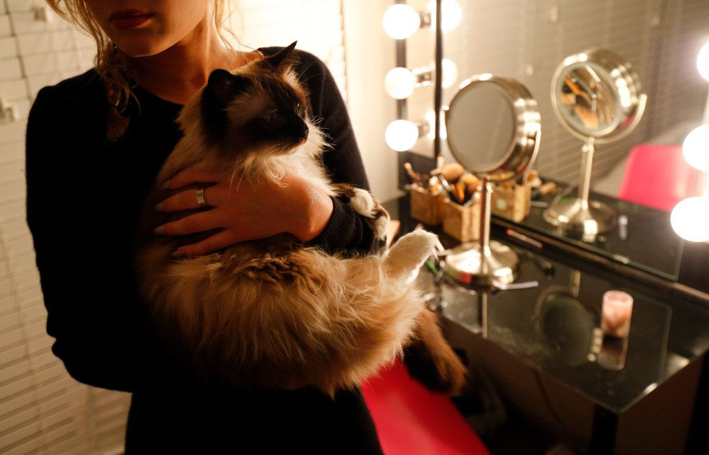 The victim was photographed with her cat in 2017 while her Title IX complaint against Lewisville ISD was still open. She ultimately lost that case but this week won her suit against the football players.