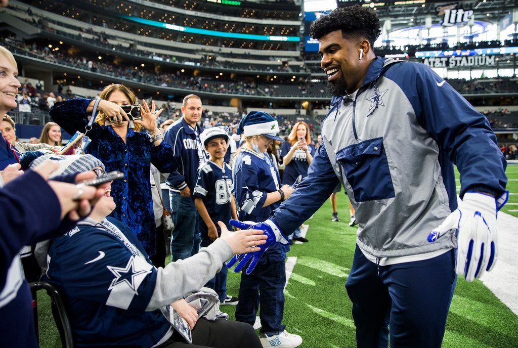 FILE - Cowboys running back Ezekiel Elliott (21) greets fans on the sideline before a game against the Seattle Seahawks on Sunday, Dec. 24, 2017, at AT&T Stadium in Arlington. (Ashley Landis/The Dallas Morning News)